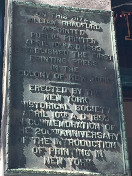 Plaque on the side of a building